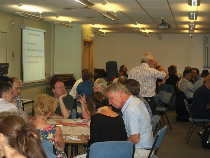 People discussing their ideas in the public meeting 150714