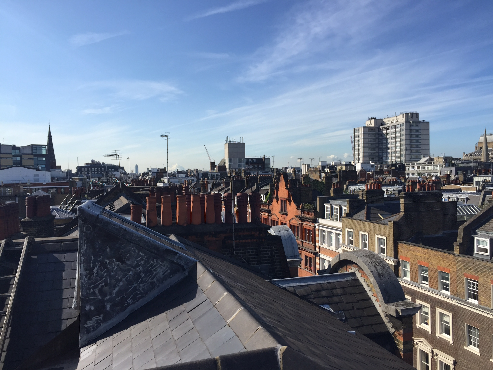 View over the rootops looking south along Great Titchfield Street. The spires of All Saints and All Soul's are both visible.